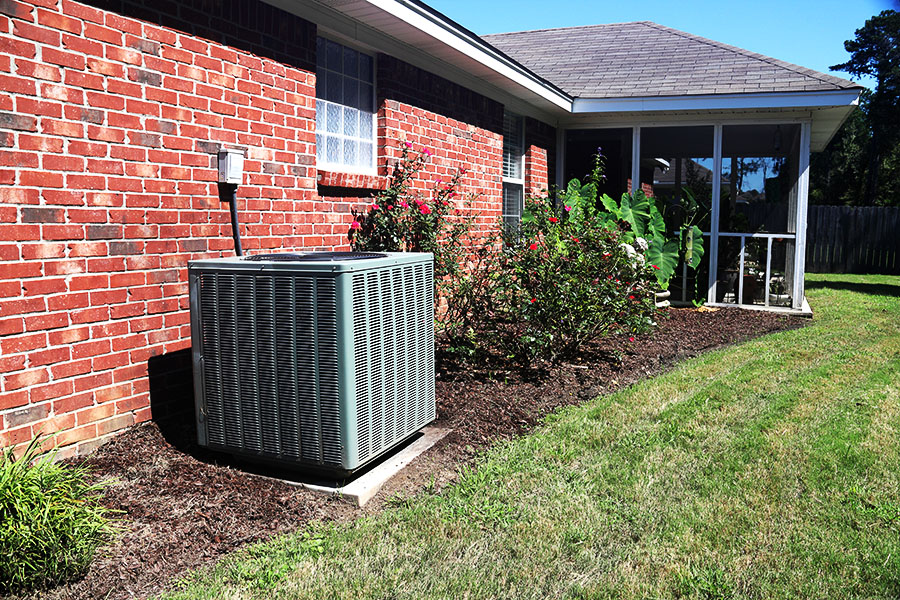 Heating and cooling equipment installed outside home