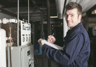 HVAC technician noting down heating units