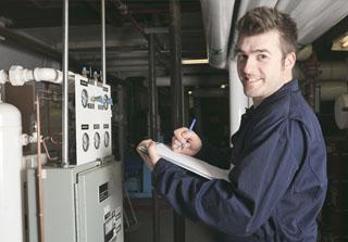HVAC technician noting down heating units