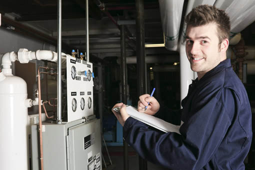 HVAC technician measuring heating cooling efficiency