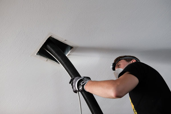 Sam Peters Air duct cleaning professional in action