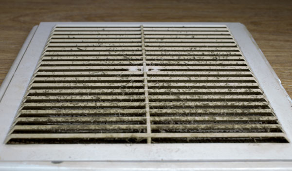 White AC Unit clogged air vents